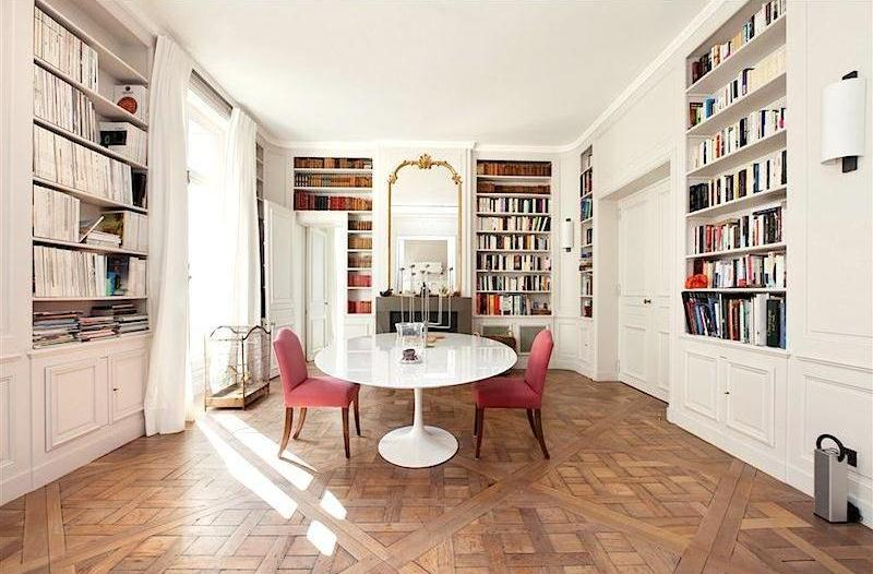 sothebys paris apartment neuilly sur seine dining room books built in bookshelves shelves parquet floors saarinen white tulip table cococozy